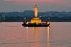 Buddha statue at dusk in Hussain Sagar in Hyderabad, India.