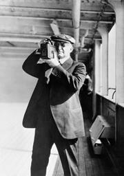 George Eastman, founder of Kodak, taking a photograph