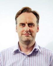 A headshot of James Bleach