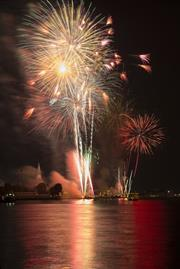 A photograph of a colourful fireworks display in Thailand