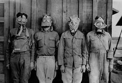 Soldiers wearing WW1 gas masks. L-R: American, British. French, German. 1917-18.