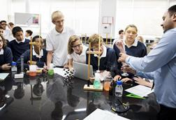 Enthralled students watch a science experiment