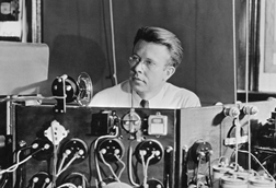 An image showing Ernest Orlando Lawrence at the controls of the 37-inch cyclotron around 1938
