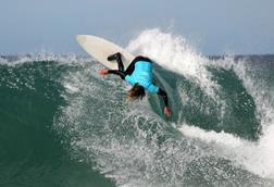 A photograph of a surfer riding a wave