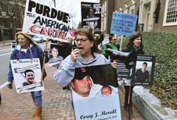 Photo of Cheryl Juaire holding speakerphone, leading protesters near the Arthur M. Sackler Museum at Harvard University, in the US