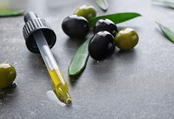 A picture of olive oil in a pipette