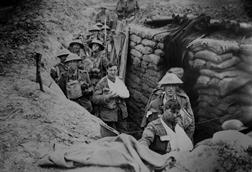 Bandaged British World War 1 soldiers in a battlefield trench, 1915-1918.