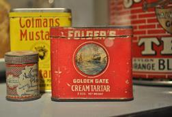 Early to mid 20th century product tins most visibly one from Folger's Golden Gate Cream Tartar, Edmonds Historical Museum, Edmonds, Washington, USA.