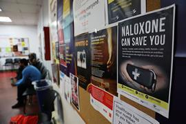 A sign for Naloxone in a room where students learn about opioid overdose prevention