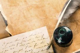 Feather pen, inkwell and letter