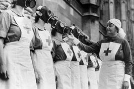 Nurses from the House of Lords Red Cross Detachment wearing gas masks,
