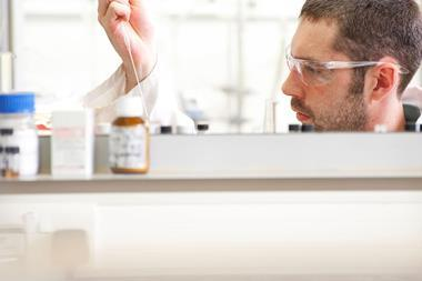 A man doing experiments in a chemistry lab