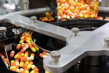 Medicine capsules in a factory production line