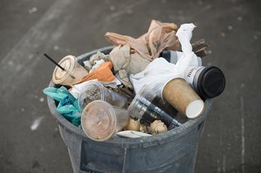 A bin-full of trash on the street of New York City