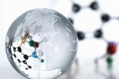 An image showing a world globe and a molecular model