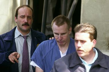 Dr Michael Swango being led out of a US District Court in Uhio