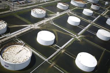 Rainwater from hurricane Harvey surrounding oil refinery storage tanks