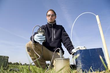 A man using equipment to test the soil