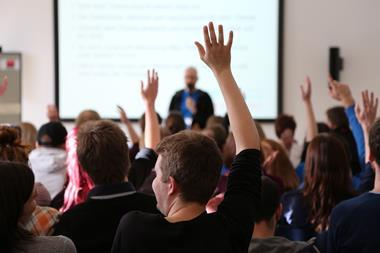 A picture showing students Raising Hands During Seminar
