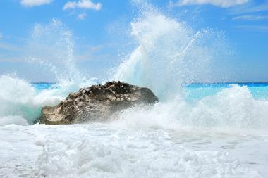 Waves splashing on a rock producing spray
