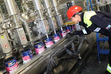 Paint tins being filled by machines at the AkzoNobel Ashington factory