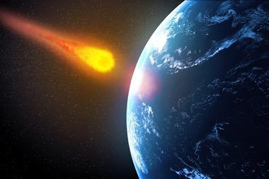 An illustration showing an asteroid falling on Earth