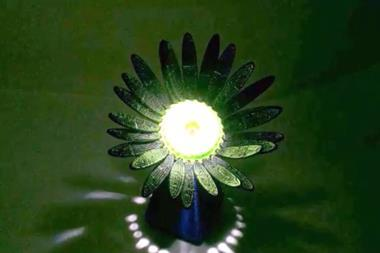 An artificial flower that opens when light is shined on it