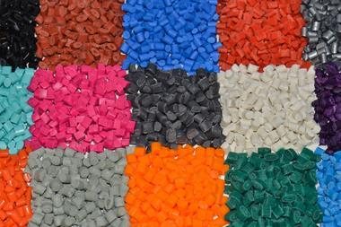 Several dyed plastic granulates in colour laboratory