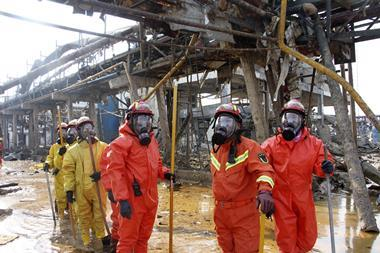 An image showing firefighters working on the rubble of a chemical factory after the explosion in Yancheng