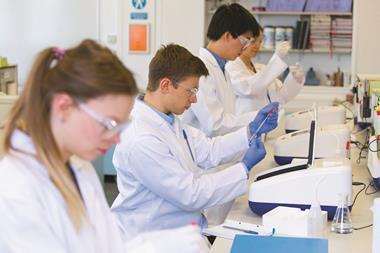 Chemistry students using UV spectrometers