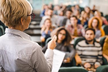 An image showing a university professor giving lecture