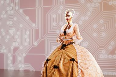 A picture showing a female cyborg wearing ball gown