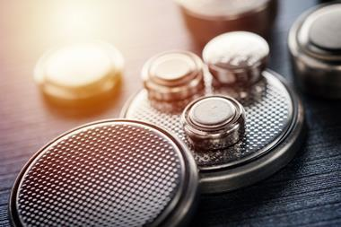 closeup button cell battery or watch battery or coin cell, used to power small electronics devices such as wrist watches or computer motherboard