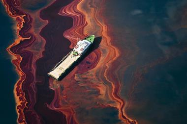 A ship drifts through a heavy band of oil, spilled from Deepwater Horizon wellhead in the Gulf of Mexico, May 2010