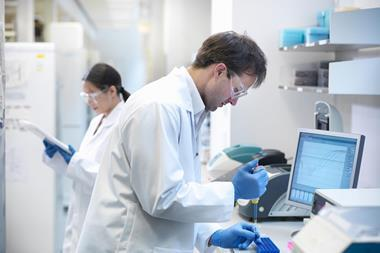 Research scientists in laboratory