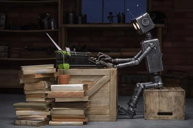 Robot sitting at desk with typewriter