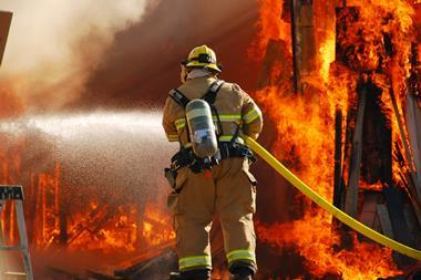 An image of a firefighter tackling a large blaze