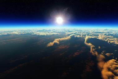Sunrise over cloudy ocean from outer space