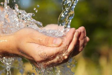 Clean drinking water in cupped hands