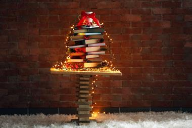 A Christmas tree structure made from a pile of books
