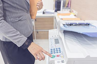 Woman photocopying