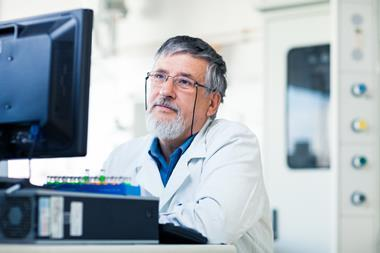Senior researcher using a lab computer