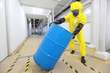Rolling a barrel of chemicals