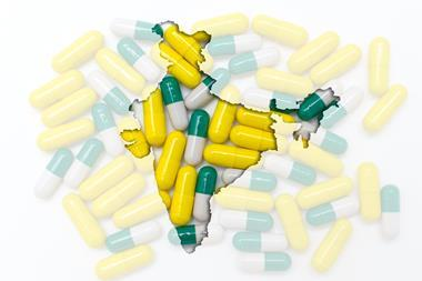 Map of India overlaid against an image of pharmaceutical capsules