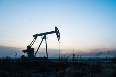 An image showing an oil pump in an oil field