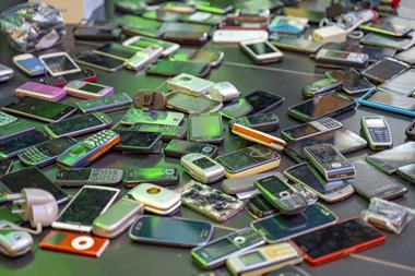 A collection of old mobile phones for recycling