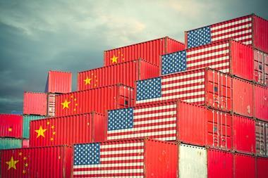 Chinese and United States cargo containers painted with their national flags sitting side by side