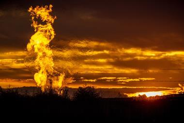 Flames from a flaring pit near a well in the Bakken Oil Field - hero (flipped)