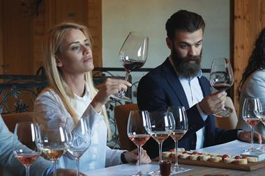 An image showing people testing wine