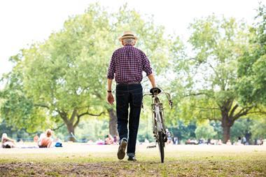 A picture of an old man with a bike